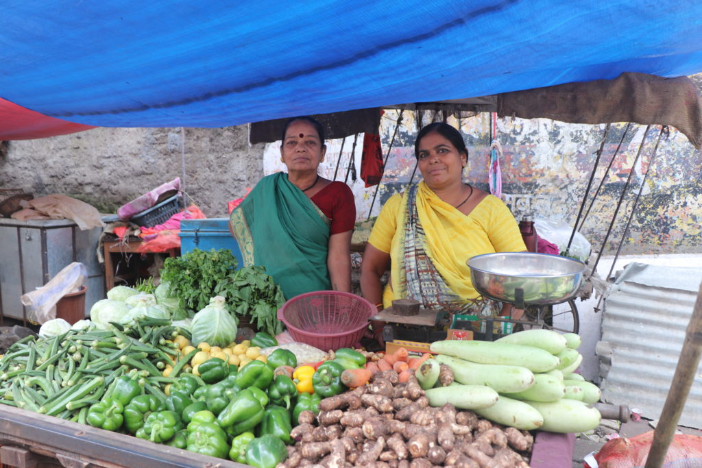 Street Vendor Rajani Varni's family helps her out at her three market stalls in Indore, India