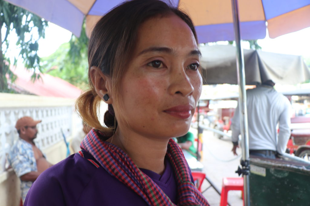 Dy Thona runs a drinks and foods cart outside hospital gates in Phnom Penh Cambodia