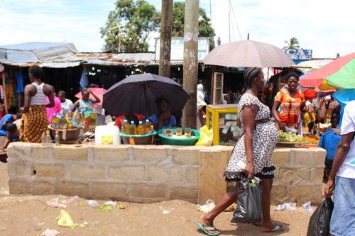 Customers and street vendors at the Duala Market in Monrovia, Liberia
