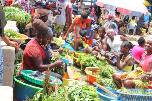 Women shell produce in the Duala Market, Monrovia, Liberia.